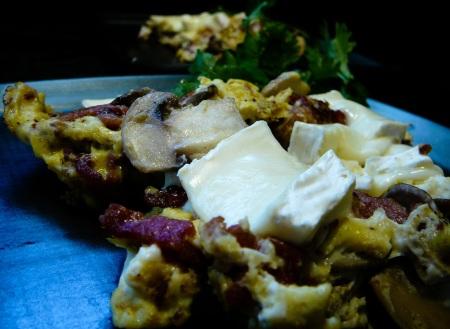 musrhoom bacon brie eggs served